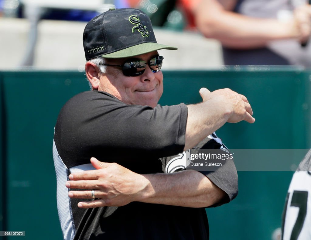 Manager Rick Renteria #17 of the Chicago White Sox signals to second baseman Yoan Moncada of the Chicago White Sox after Moncada caught a fly ball hit by Jose Iglesias of the Detroit Tigers during the fifth inning at Comerica Park on May 27, 2018 in Detroit, Michigan. The Tigers defeated the White Sox 3-2.