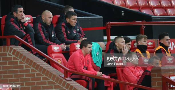 Manager Ricky Sbragia of Manchester United U23s watches from the dugout during the Premier League 2 match between Manchester United U23s and Reading...