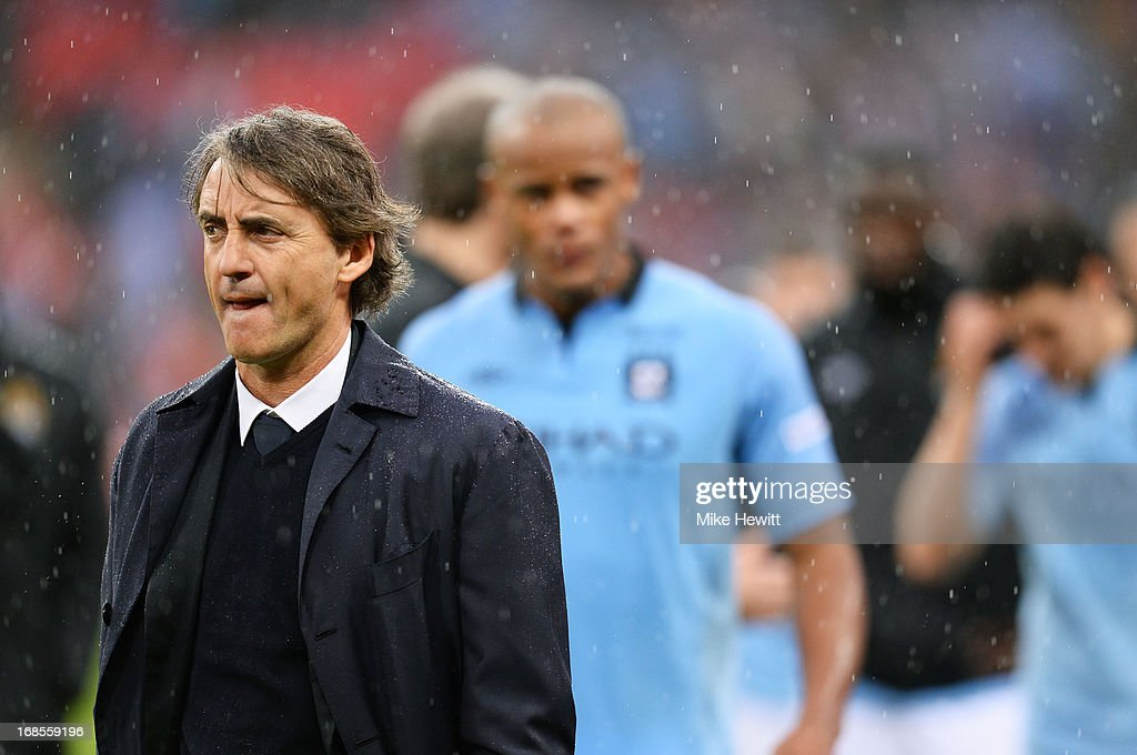 https://media.gettyimages.com/photos/manager-roberto-mancini-of-manchester-city-and-vincent-kompany-look-picture-id168559196
