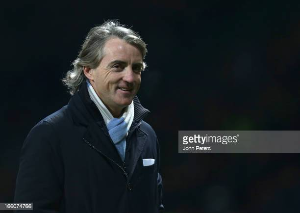 Manager Roberto Mancini of Manchester City celebrates at the end of the Barclays Premier League match between Manchester United and Manchester City...