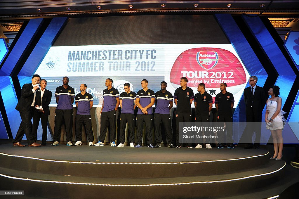 Manager Roberto Mancini, Yaya Toure, Pablo Zabaleta, Vincent Kompany, Adam Johnson and Aleksander Kolarov of Manchester City on stage with Wojciech Szczesny, Alex Oxlade-Chamberlain and Theo Walcott and manager Arsene Wenger of Arsenal at a charity dinner ahead of their pre-season friendly match during Arsenal's Asian Tour on July 25, 2012 in Beijing, China.