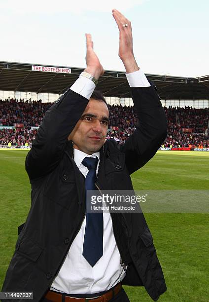 Manager Roberto Martinez celebrateS after winning 10 to keep them in the Premiere League during the Barclays Premier League match between Stoke City...