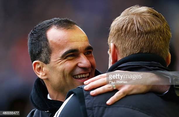 Manager Roberto Martinez of Everton greets manager Garry Monk of Swansea City during the Barclays Premier League match between Everton and Swansea...