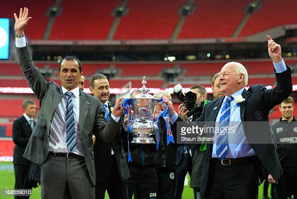 Manager Roberto Martinez of Wigan Athletic and Wigan chairman Dave Whelan celebrate with the trophy following his team's 10 victory during the FA Cup...