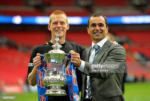 Manager Roberto Martinez of Wigan Athletic and winning goalscorer Ben Watson celebrate with the trophy following their team's 10 victory during the...