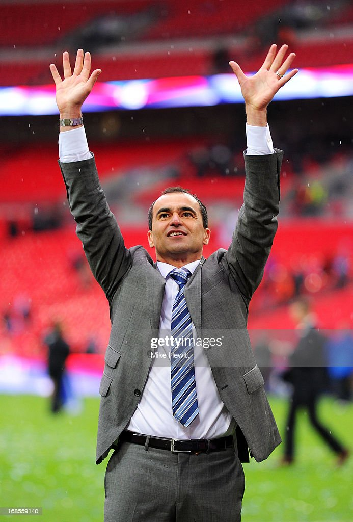 Manager Roberto Martinez of Wigan Athletic celebrates victory after the FA Cup with Budweiser Final between Manchester City and Wigan Athletic at Wembley Stadium on May 11, 2013 in London, England.