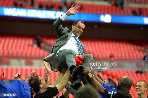Manager Roberto Martinez of Wigan Athletic celebrates victory with his players after the FA Cup with Budweiser Final between Manchester City and...