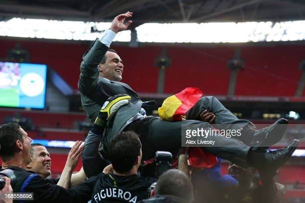 Manager Roberto Martinez of Wigan Athletic is thrown into the air by his players following their team's 1-0 victory during the FA Cup with Budweiser...