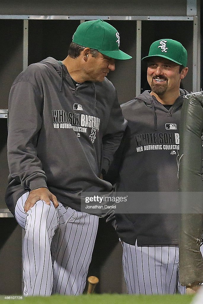 Manager Robin Ventura #23 of the Chicago White Sox (L) chats with Paul Konerko #14 during a game against the Kansas City Royals at U.S. Cellular Field on September 25, 2014 in Chicago, Illinois.