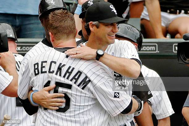 Manager Robin Ventura of the Chicago White Sox hugs Gordon Beckham after he hit a walkoff homerun against the Texas Rangers during the eleventh...