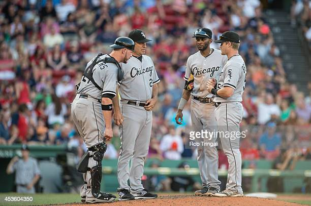 Manager Robin Ventura of the Chicago White Sox meets on the mound with Tyler Flowers Alexei Ramirez and Gordon Beckham during the game against the...