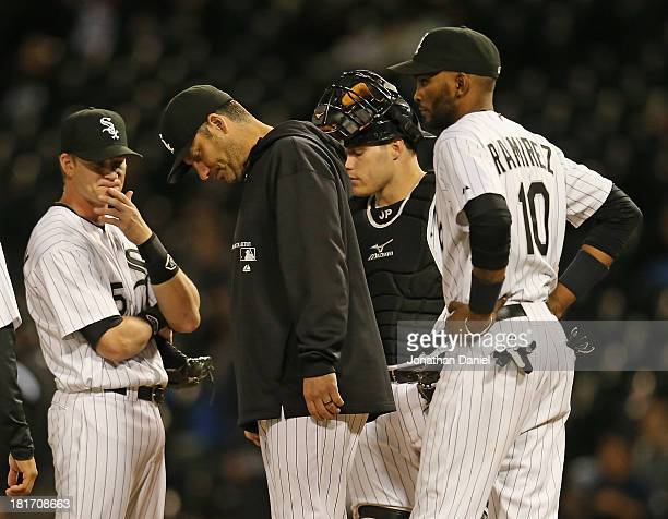 Manager Robin Ventura of the Chicago White Sox waits on the mound with Gordon Beckham Josh Phegley and Alexei Ramirez during a pitching change in the...