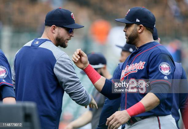 Manager Rocco Baldelli of the Minnesota Twins celebrates with Nelson Cruz of the Minnesota Twins after a 122 win over the Detroit Tigers at Comerica...