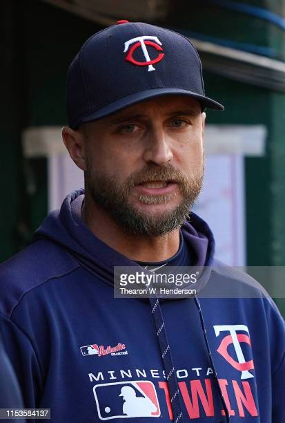 Manager Rocco Baldelli of the Minnesota Twins looks on from the dugout against the Oakland Athletics in the top of the sixth inning at OaklandAlameda...