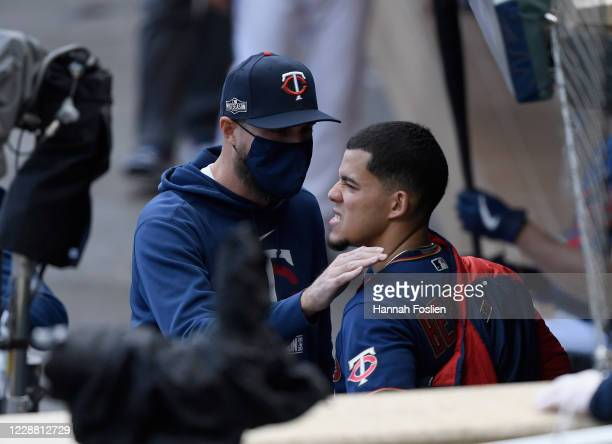 Manager Rocco Baldelli of the Minnesota Twins speaks to starting pitcher Jose Berrios in the dugout during the fifth inning of Game Two in the...