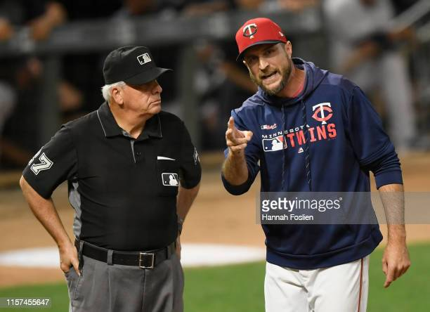 Manager Rocco Baldelli of the Minnesota Twins speaks with umpire Larry Vanover after being ejected from the game against the New York Yankees during...