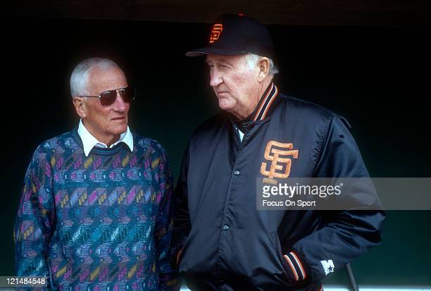 Manager Roger Craig of the San Francisco Giants talks with general manager Al Rosen before the start of a Major League Baseball game circa 1986 at...