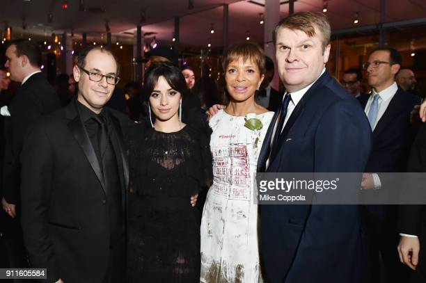 Manager Roger Gold recording artist Camila Cabello president of Epic Records Sylvia Rhone and CEO of Sony Music Entertainment Rob Stringer attend the...