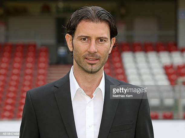 Manager Roland Benschneider poses during the FC Energie Cottbus team presentation at Stadion der Freundschaft on July 8 2014 in Cottbus Germany