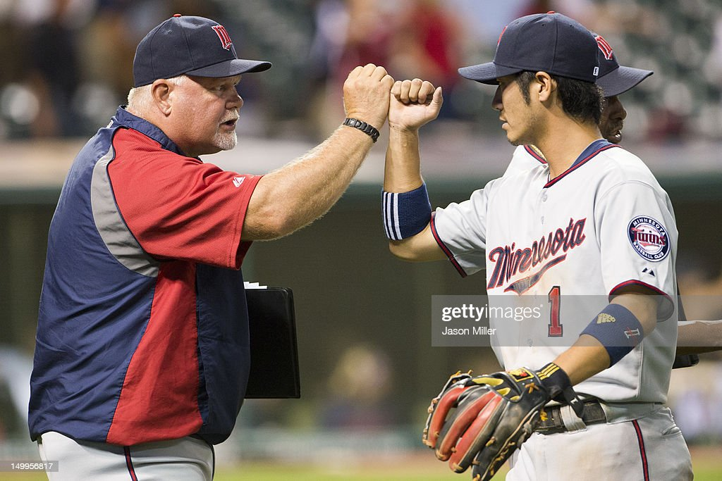 Manager Ron Gardenhire #35 congratulates Tsuyoshi Nishioka #1 of the Minnesota Twins after the Twins defeated the Indians at Progressive Field on August 7, 2012 in Cleveland, Ohio. The Twins defeated the Indians 7-5.