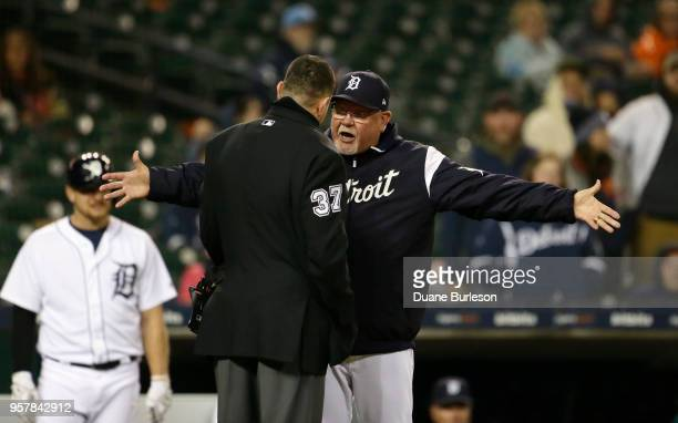 Manager Ron Gardenhire of the Detroit Tigers argues with home plate umpire Carlos Torres after being ejected during the fifth inning of game two of a...