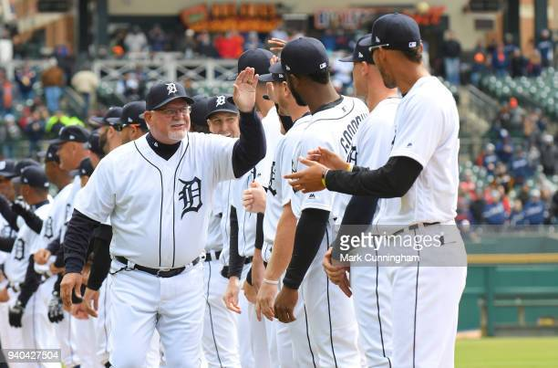 Manager Ron Gardenhire of the Detroit Tigers gets highfives from his players during player introductions prior to the Opening Day game against the...