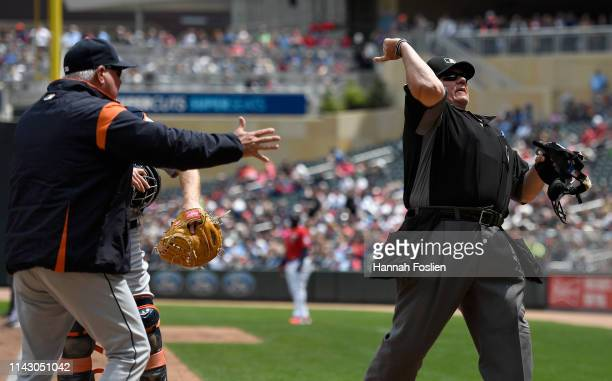 Manager Ron Gardenhire of the Detroit Tigers is ejected by home plate umpire Hunter Wendelstedt during the third inning of game one of a doubleheader...
