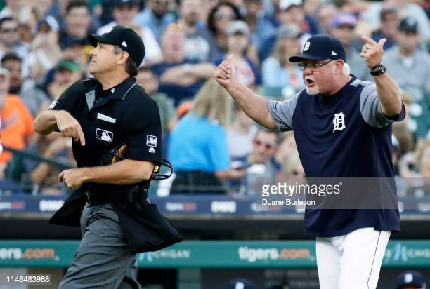 Manager Ron Gardenhire of the Detroit Tigers is tossed by home plate umpire James Hoye left while argue a balk called against Tigers pitcher Matthew...