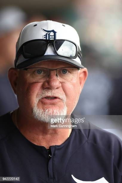 Manager Ron Gardenhire of the Detroit Tigers looks on from the dugout during the Spring Training game against the New York Yankees at Publix Field at...