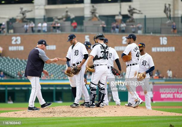 Manager Ron Gardenhire of the Detroit Tigers takes the ball from David McKay during the seventh inning of the game against the New York Yankees at...