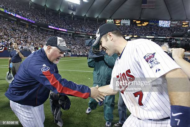Manager Ron Gardenhire of the Minnesota Twins celebrates the win over the Detroit Tigers with Joe Mauer on October 6 2009 at the Metrodome in...