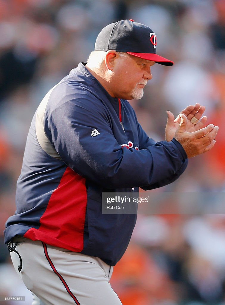 Manager Ron Gardenhire of the Minnesota Twins heads to the mound to make a pitching change in the fifth inning against the Baltimore Orioles during opening day at Oriole Park at Camden Yards on April 5, 2013 in Baltimore, Maryland.