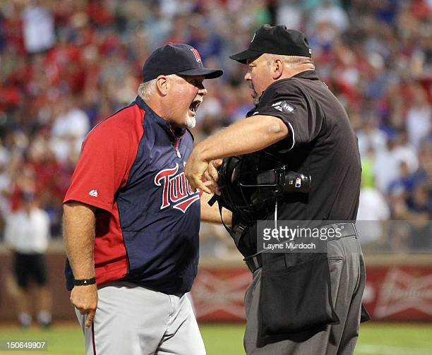 Manager Ron Gardenhire of the Minnesota Twins is ejected by home plate umpire Wally Bell after arguing about his pitcher Scott Diamond being ejected...