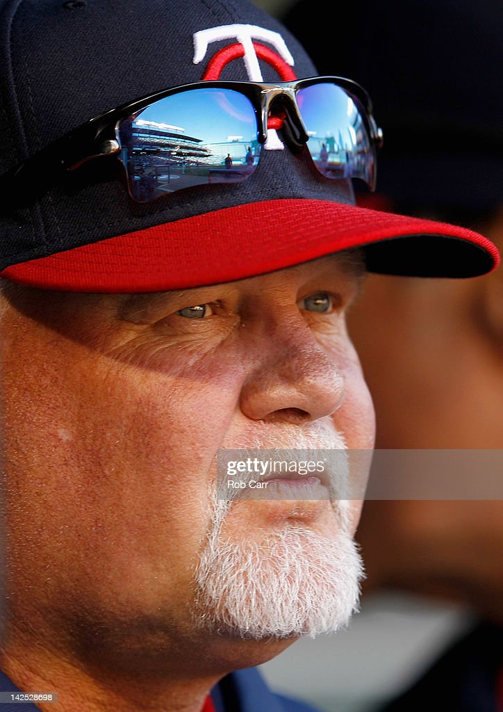 Manager Ron Gardenhire #35 of the Minnesota Twins looks from the dugout during the eighth inning of the Twins 4-2 loss to the Baltimore Orioles on opening day at Oriole Park at Camden Yards on April 6, 2012 in Baltimore, Maryland.