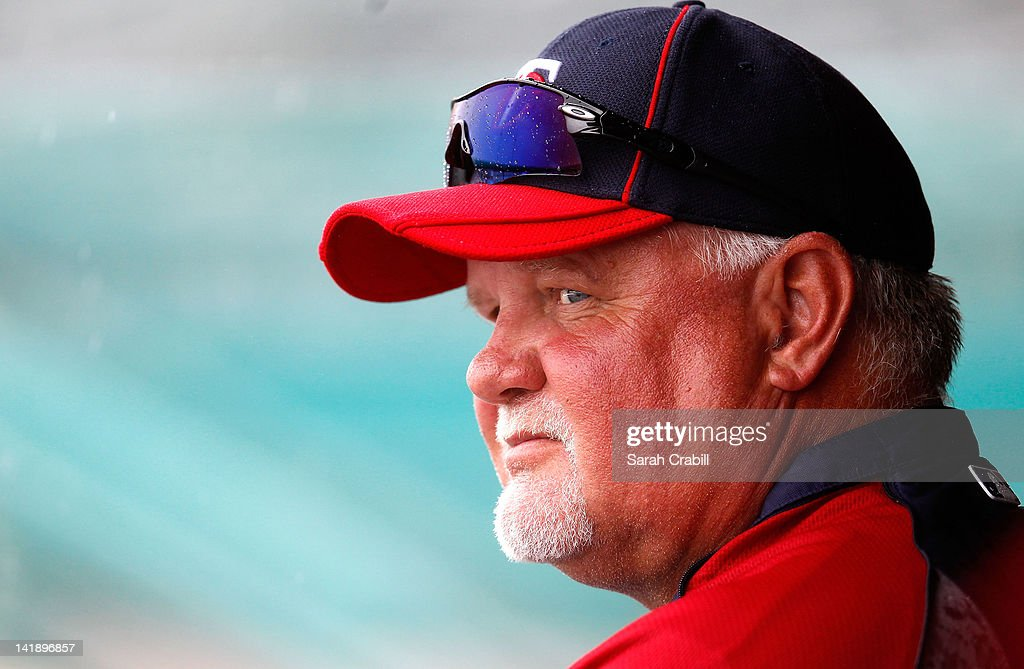 Manager Ron Gardenhire #35 of the Minnesota Twins looks on during a rain delay during a game against the St. Louis Cardinals at Roger Dean Stadium on March 25, 2012 in Jupiter, Florida.