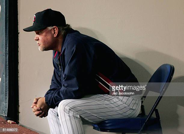 Manager Ron Gardenhire of the Minnesota Twins looks out at the field just after Ruben Sierra of the New York Yankees hit a game tying three run home...