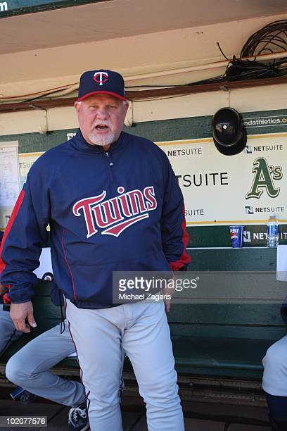 Manager Ron Gardenhire of the Minnesota Twins standing in the dugout prior to the game against the Oakland Athletics at the Oakland Coliseum on June...