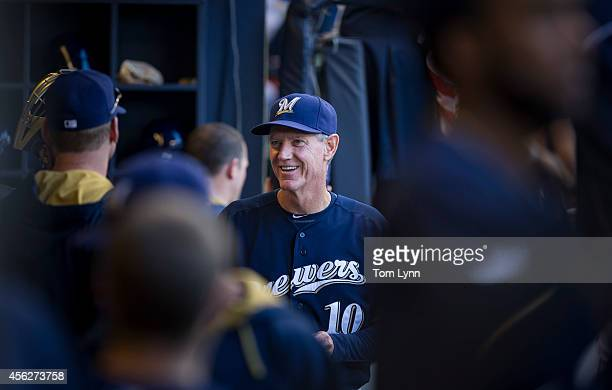 Manager Ron Roenicke of the Milwaukee Brewers in the dugout during the game against the Chicago Cubs at Miller Park on September 28 2014 in Milwaukee...