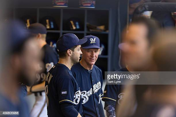 Manager Ron Roenicke of the Milwaukee Brewers in the dugout during the game with the Chicago Cubs at Miller Park on September 28 2014 in Milwaukee...