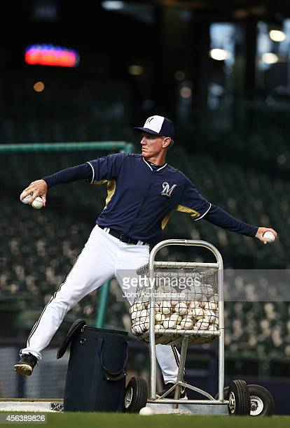Manager Ron Roenicke of the Milwaukee Brewers pitches during warm ups before their game against the Cincinnati Reds on September 13 2014 at Miller...