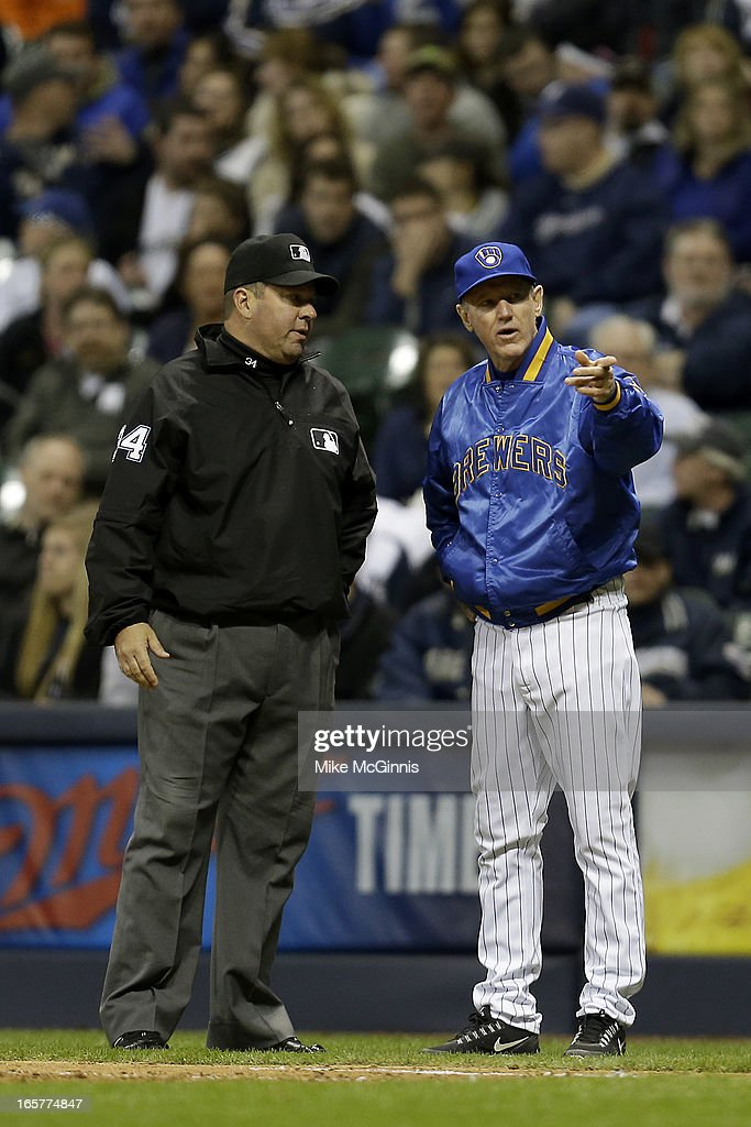 Manager Ron Roenicke #10 of the Milwaukee Brewers talks to first base umpire Sam Holbrook #34 about a ball hit by Norichika Aoki in the bottom of the eighth inning against the Arizona Diamondbacks at Miller Park on April 5, 2013 in Milwaukee, Wisconsin.