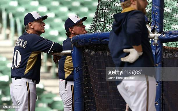 Manager Ron Roenicke of the Milwaukee Brewers watches warm ups before their game against the Cincinnati Reds on September 13 2014 at Miller Park in...