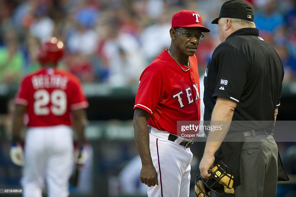 Manager Ron Washington #38 of the Texas Rangers has words with home plate umpire Bill Miller #26 after Adrian Beltre #29 was called out during the third inning against the Houston Astros on July 9, 2014 at Globe Life Park in Arlington in Arlington, Texas.