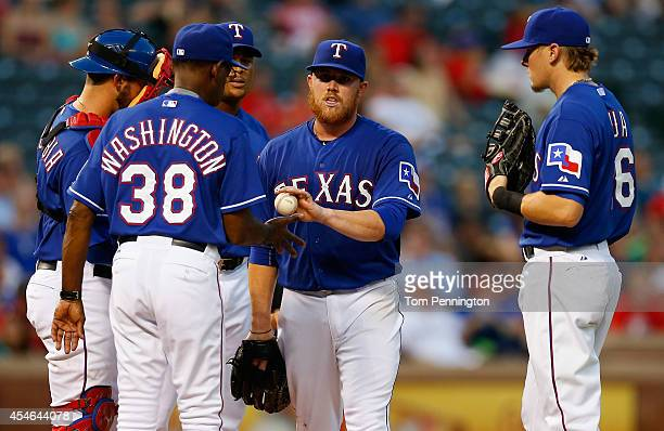 Manager Ron Washington of the Texas Rangers pulls starting pitcher Robbie Ross Jr of the Texas Rangers from the game against the Seattle Mariners in...