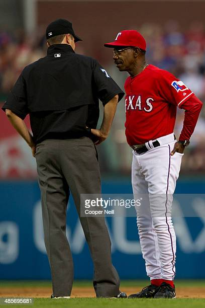 Manager Ron Washington of the Texas Rangers speaks with umpire John Tumpane after a close call during the second inning against the Chicago White Sox...