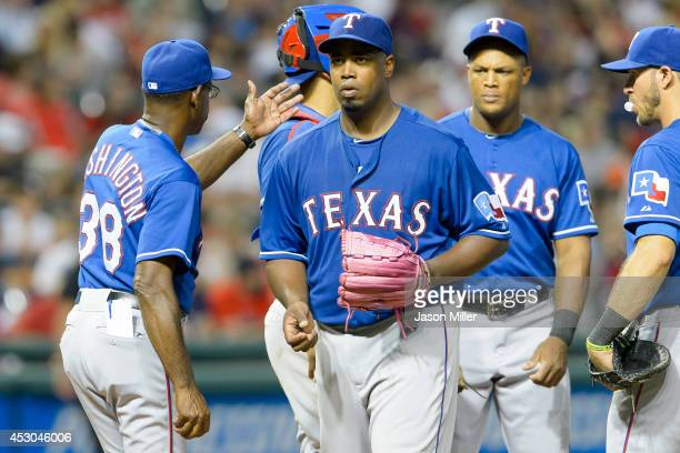 Manager Ron Washington takes starting pitcher Jerome Williams of the Texas Rangers out of the game during the fifth inning against the Cleveland...