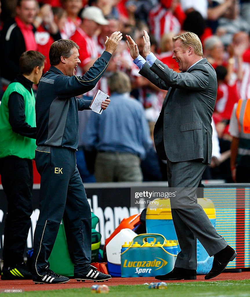 Manager Ronald Koeman (R) of Southampton celebrates their victory with assitant manager Erwin Koeman of Southampton during the Barclays Premier League match between Southampton and Queens Park Rangers at St Mary's Stadium on September 27, 2014 in Southampton, England.