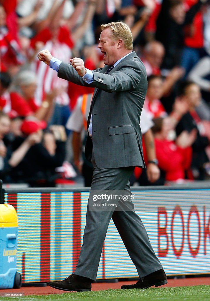 Manager Ronald Koeman of Southampton gcelebrates their victory during the Barclays Premier League match between Southampton and Queens Park Rangers at St Mary's Stadium on September 27, 2014 in Southampton, England.