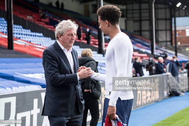 manager Roy Hodgson of Crystal Palace and Dele Alli of Tottenham Hotspur talk on pitch after the Premier League match between Crystal Palace and...
