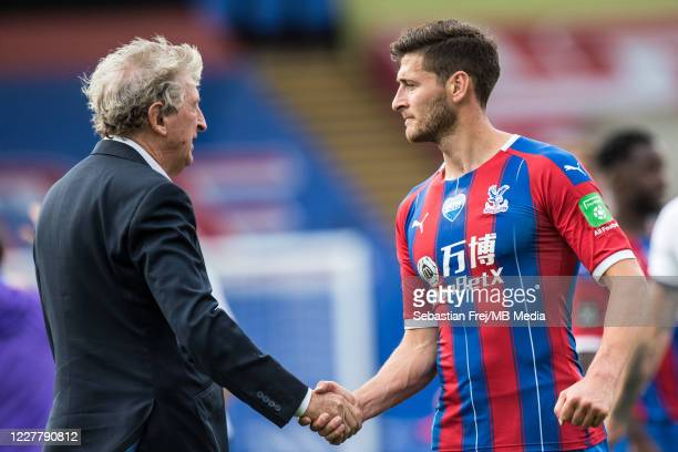 manager Roy Hodgson of Crystal Palace and Joel Ward of Crystal Palace reaction on pitch after the Premier League match between Crystal Palace and...
